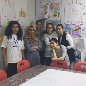 Ketchum Raad Middle East colleagues pose with the project manager of START, an organization that hosts workshops using art as a medium to support the development of children with special needs, at the Al Manzil Center.