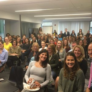 Washington, DC colleagues gather together for their monthly staff meeting.