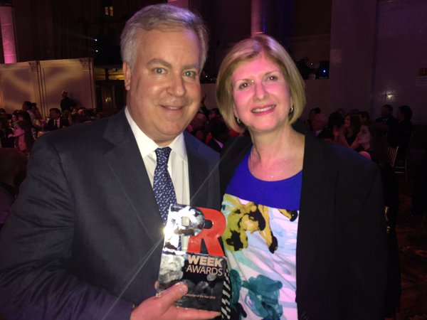"Edna Johnson from Michelin (*client) and Ketchum's Paul Wood posed with their PRWeek Award for Community Relations Campaign of the Year for Michelin's ""Beyond the Driving Test – Michelin Puts Airs in Teens' Tire Awareness"" campaign."