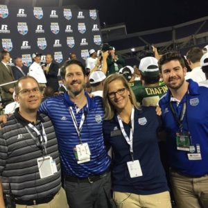 What a score: KSE colleagues joinedRussell Athletic(*cl) on the field at the Russell Athletic Bowl.