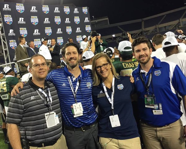 What a score: KSE colleagues joined Russell Athletic (*cl) on the field at the Russell Athletic Bowl.